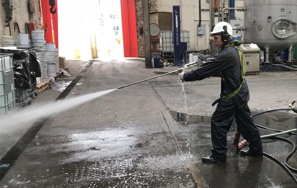 Picture of a member of BCJ staff using high pressure Water jetting equipment